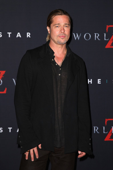Brad Pitt kept his look laid-back with this baggy black blazer and polo shirt combo at the 'World War Z' Australian premiere.