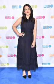 Black ankle-strap pumps completed Abbi Jacobson's simple outfit.