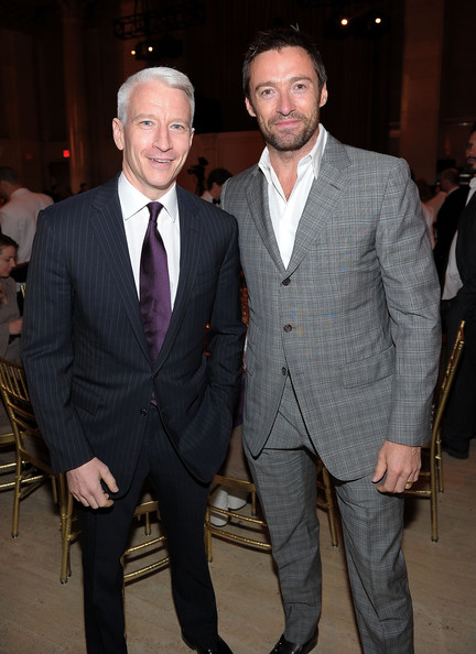 Hugh looks dapper as always in this gray plaid single breasted suit.