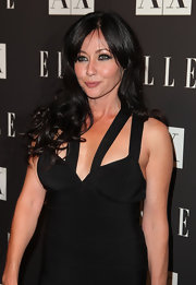 Shannon Doherty showed off her long brunette curls while hitting the Armani Exchange party.