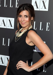 Actress Jamie-Lynn Sigler paired her demur cocktail dress with a loose bun.