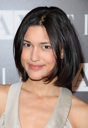 Julia Jones sported a sleek center part bob while hitting the Armani Exchange party.