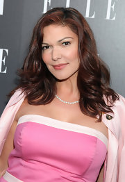 Laura Harring showed off her medium length curls while hitting the Armani Exchange party.