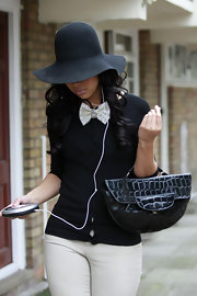 Rebecca Ferguson tried to keep a low profile on the streets of London with a floppy black suede hat.