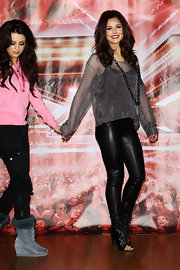 Cheryl wore a sheer shimmering sweater with her leather pants and chain necklace.