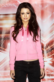 Cher Lloyd rocked soft brunette curls at the 'X Factor' press conference.