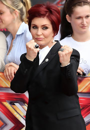 Sharon Osbourne wore a pair of pearl drop earrings at the 'X Factor' photocall.