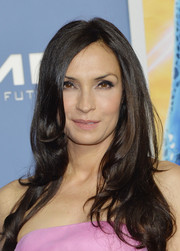 Famke Janssen went for an ultra-feminine vibe with this long wavy hairstyle teamed with a pink strapless dress at the 'X-Men' world premiere.