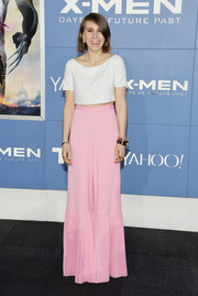 Zosia Mamet injected a quirky touch with a pair of pink wide-leg pants with pleated detailing, also by Honor.