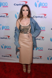 Daya teamed her cami with a nude leather pencil skirt and an oversized denim jacket.