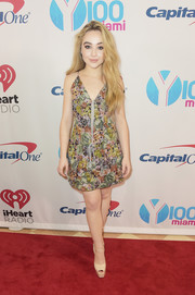 Sabrina Carpenter cut an ultra-feminine figure in a Thai Ngyuen Atelier floral mini dress during Y100's Jingle Ball 2017.