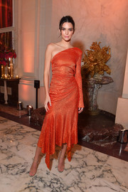 Kendall Jenner was on fire in a red-orange one-sleeve dress by Alexandre Vauthier Couture at the YouTube cocktail party during Paris Fashion Week.