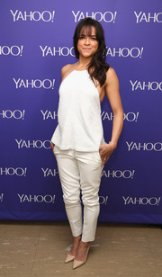 Michelle Rodriguez went for a monochromatic finish with a pair of white cigarette pants.