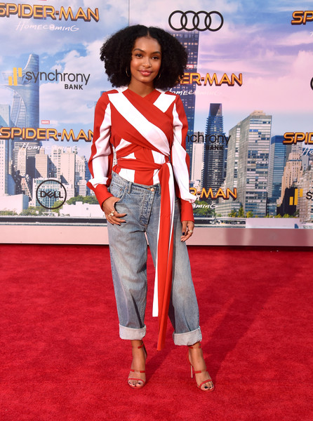 Yara Shahidi Strappy Sandals [spider-man: homecoming - arrivals,spider-man: homecoming,red carpet,carpet,clothing,red,flooring,fashion,premiere,denim,jeans,pantsuit,yara shahidi,california,hollywood,tcl chinese theatre,columbia pictures,premiere,premiere]