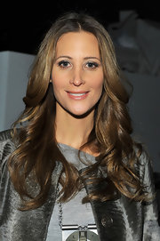 Stephanie wore her highlighted locks in center part long curls at the Yigal Azrouel show.