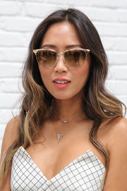 Aimee Song accessorized with a pair of metallic shades for a cool finish to her look.
