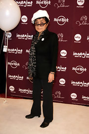 Yoko Ono advocated peace in a black graphic scarf with peace signs at the Imagine There's No Hunger event.