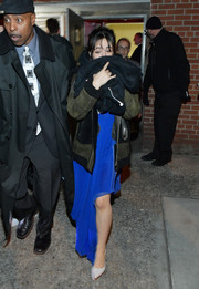 Camila Cabello headed out on a cold night in New York City wearing a green and black suede jacket by Karl Lagerfeld.