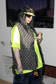 Billie Eilish rocked a pair of neon-yellow shield sunglasses during Coachella 2019.