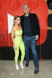 Maren Morris was sporty-sexy in a neon-yellow crop-top at the launch of her new album, 'Girl.'