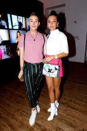 Emma Chamberlain opted for a casual white turtleneck when she attended the launch of YouTube.com/Fashion.
