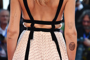 Chiara Ferragni has a heart tattoo on her arm with the words 'You are hotter than the flames in hell.'