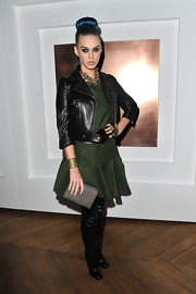 Katy Perry gave her green fit-and-flare dress a rebellious edge with a leather biker jacket.