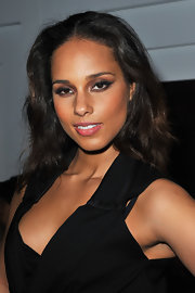 Alicia Keys used rich aubergine and shimmering bronze shadows and black liner to create her smoky-eyed look at the Yves Saint Laurent fall 2012 fashion show in Paris.