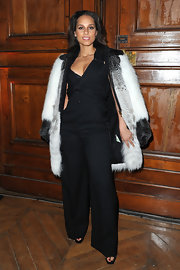 Alicia Keys wore this black jumpsuit with an over-the-top fur coat to the YSL show in Paris.