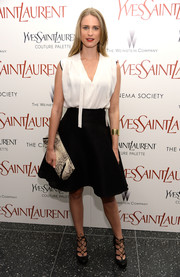 Julie Henderson cut a classic silhouette in this flared black skirt and loose white blouse combo.
