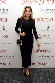 Chelsea Leyland showed off her slim figure in a body-con sheer-panel LBD during the 'Yves Saint Laurent' premiere.