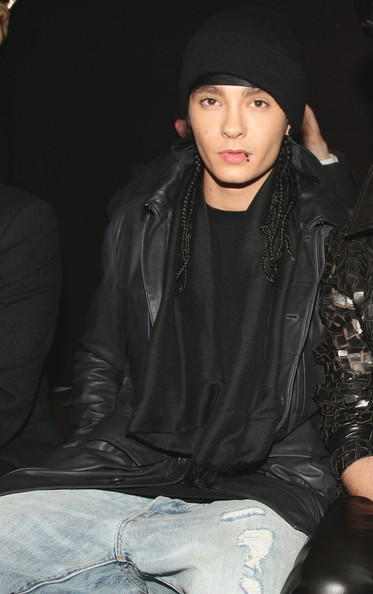Tom wears all black to the Autumn/Winter show.