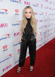 Sabrina Carpenter teamed her top with a pair of black leather parachute pants, also by Sally LaPointe.