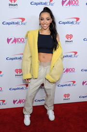 Tinashe hit the Z100 Jingle Ball red carpet wearing an oversized yellow leather jacket.