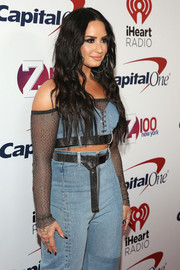 Demi Lovato attended Z100's Jingle Ball 2017 wearing denim separates styled with gunmetal belts.