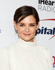 Katie Holmes finished off her look with delicate gold hoops.