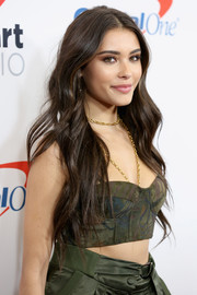Madison Beer styled her outfit with a layered gold chain necklace.