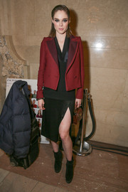 Coco Rocha wore a red cropped jacket for a splash of color to her black dress and boots combo at the Zac Posen fashion show.