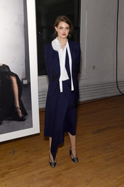 Lindsey Wixson suited up in this asymmetrical blue jacket and skirt set for the Zac Posen exhibition.