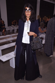 Crystal Renn finished off her outfit with a navy duster coat.
