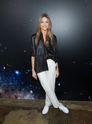 Martha Hunt teamed her shirt with a pair of white slacks.