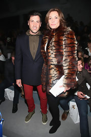 LuAnn de Lesseps showed off her Countess-appropriate style in a tiger-print fur coat while attending Zang Toi's Fall 2013 runway show.
