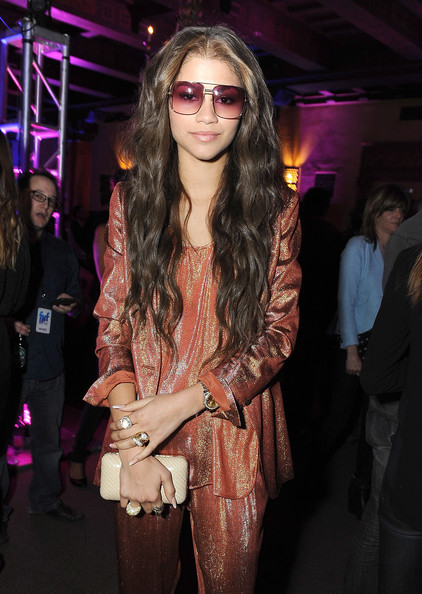 Zendaya Coleman Leather Clutch [zendaya,eyewear,fashion,glasses,event,vision care,sunglasses,fashion design,long hair,cool,outerwear,friends n family 17th annual pre-grammy party,friends n family 17th annual pre-grammy party at park plaza hotel,california,los angeles,park plaza hotel]
