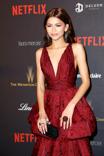 Zendaya Coleman Statement Ring [clothing,fashion model,dress,cocktail dress,red,premiere,fashion,thigh,leg,long hair,zendaya,golden globes,netflix golden globe awards,california,los angeles,the beverly hilton,weinstein company,netflix,party,arrivals]