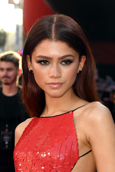 Zendaya Coleman Lipgloss [spider-man far from home,hair,face,beauty,red,model,fashion,hairstyle,lip,fashion model,brown hair,red carpet,zendaya,hair,red carpet,celebrity,tcl chinese theatre,sony pictures,premiere,premiere,zendaya,tom holland,spider-man: far from home,spider-man: homecoming,tcl chinese theatre,premiere,red carpet,celebrity,sony pictures]