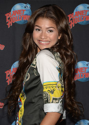 Zendaya Coleman charmed with this super-long curly 'do during her CD and book release event.