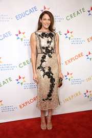 Amanda Righetti made an elegant choice with this gold and black lace midi dress by Antonio Marras for the Zimmer Children's Museum Discovery Award dinner.
