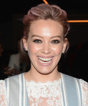 Hilary Duff styled her hair into a mildly messy updo for the Zimmermann fashion show.