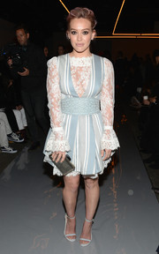 Hilary Duff gave us major Maria von Trapp vibes with this Zimmermann lace-and-stripes confection she wore to the label's fashion show.