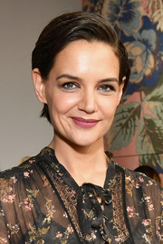 Katie Holmes finished off her look with a swipe of matte berry lipstick.